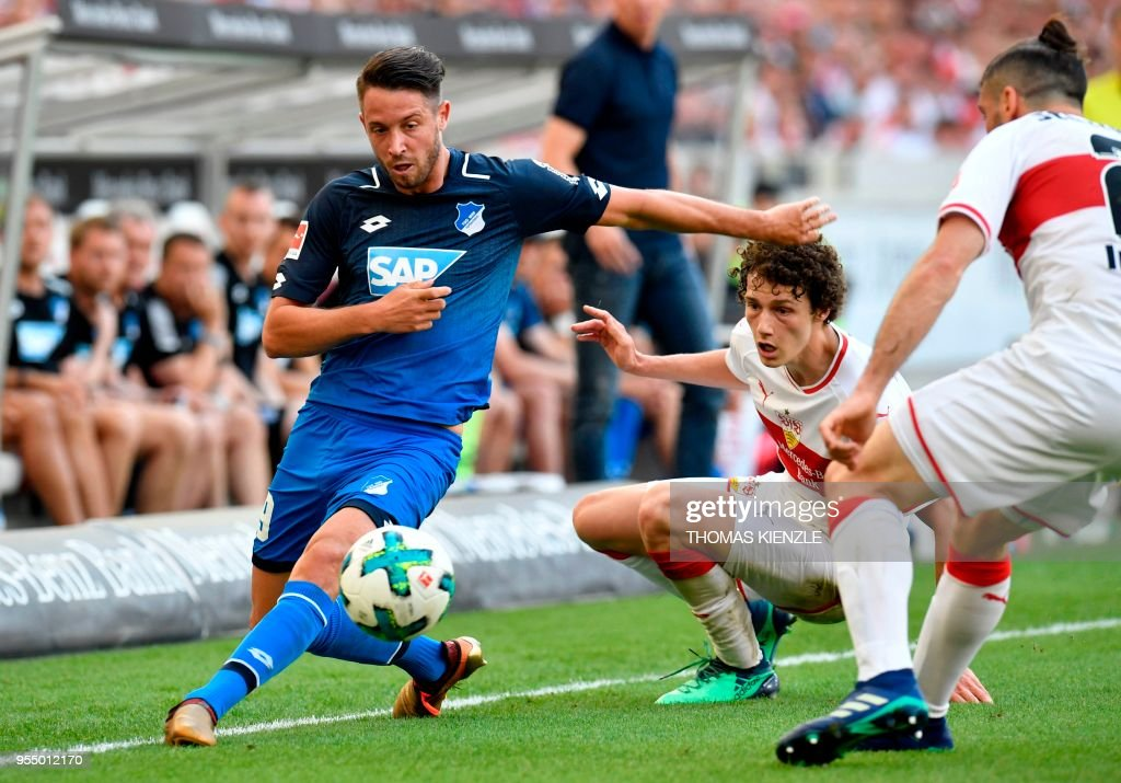 Stuttgart's Argentinean defender Emiliano Insua and French defender Benjamin Pavard vie with Hoffenheim's forward Mark Uth during the German first division Bundesliga football match VfB Stuttgart vs TSG 1899 Hoffenheim in Stuttgart, southern Germany, on May 5, 2018. (Photo by THOMAS KIENZLE / AFP)