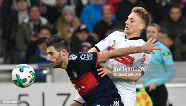 Stuttgart's Argentinean midfielder Santiago Ascacibar and Munich's Spanish defender Javi Martinez vie for the ball during the German first division...