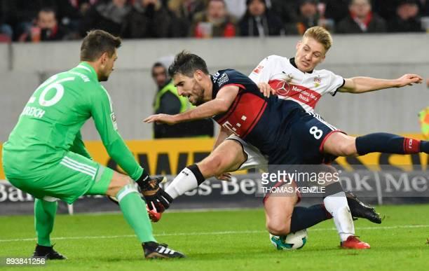 Stuttgart's Argentinean midfielder Santiago Ascacibar Munich's Spanish defender Javi Martinez and Bayern Munich's German goalkeeper Sven Ulreich vie...