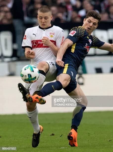Stuttgart's Argentinian midfielder Santiago Ascacibar and Leipzig's Austrian midfielder Marcel Sabitzer vie for the ball during the German first...