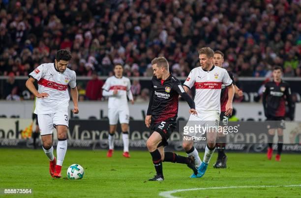 Stuttgarts Berkay Ozcan initiates a counter while Leverkusens Sven Bender tries to get the ball during the Bundesliga match between VfB Stuttgart and...