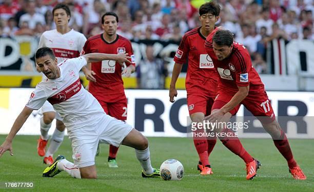 Stuttgart's BosnianHerzegovinian forward Vedad Ibisevic and Leverkusen's Polish defender Sebastian Boenisch vie for the ball during the German first...