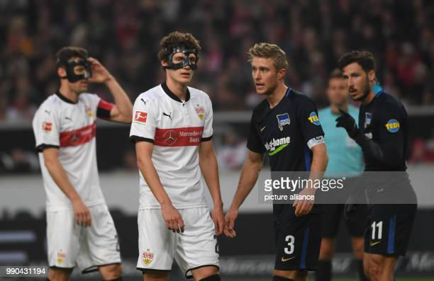 Stuttgart's Christian Gentner and Benjamin Pavard and Berlin's Per Skjelbred and Mathew Leckie pictured during the German Bundesliga football match...
