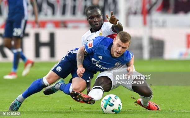 Stuttgart's Congolese forward Chadrac Akolo and Schalke's midfielder Max Meyer vie for the ball during the German first division Bundesliga football...