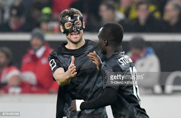 Stuttgart's Congolese forward Chadrac Akolo is congratulated by teammate midfielder Christian Gentner after he scored the opening goal during the...