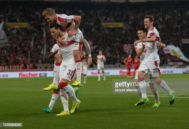 Stuttgart's Daniel Ginczek Simon Terodde Emiliano Insua Zapata and Christian Gentner celebrate the 31 goal during the German 2nd Bundesliga soccer...