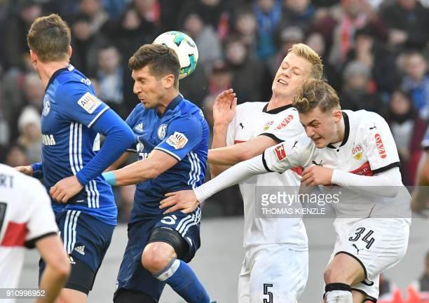 Stuttgart's Danish midfielder Jacob Bruun Larsen defender Timo Baumgartl and Schalke's Serbian defender Matija Nastasic and defender Bastian Oczipka...