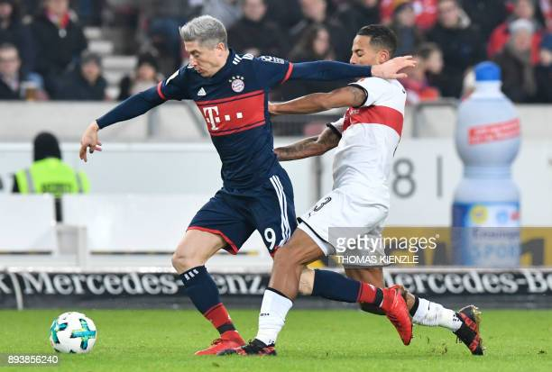Stuttgart's defender Dennis Aogo and Munich's Polish forward Robert Lewandowski vie for the ball during the German first division Bundesliga football...