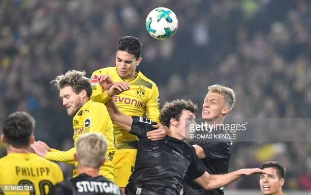 Stuttgart's defender Timo Baumgartl French defender Benjamin Pavard Dortmund's Spanish defender Marc Bartra and Dortmund's forward Andre Schuerrle...
