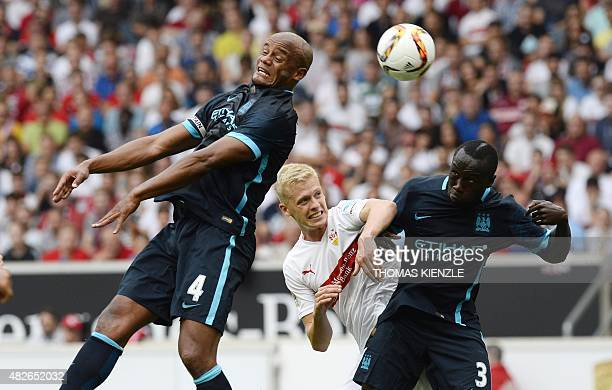 Stuttgart's defender Timo Baumgartl vies for the ball with Manchester's defender Vincent Kompany and Manchester's French defender Bacary Sagna during...