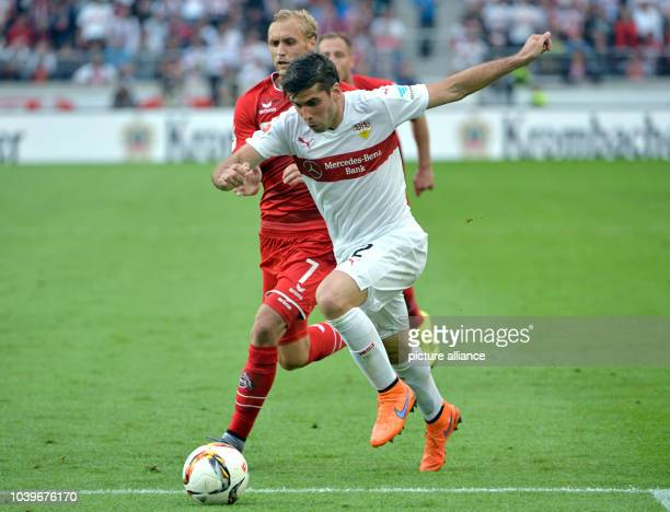 Stuttgart's Emiliano Insua Zapata and Cologne's Marcel Risse vie for the ball during the German Bundesliga football match between VfB Stuttgart and...