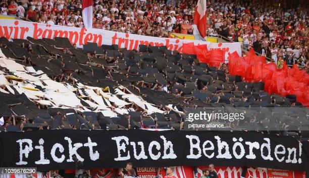 Stuttgart's fans show a banner with the writing 'Fickt euch Behörden' prior to the Bundesliga soccer match VfB Stuttgart vs 1st FSV Mainz 05 at...