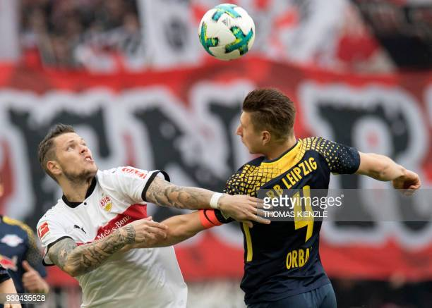Stuttgart's forward Daniel Ginczek and Leipzig's defender Willi Orban vie for the ball during the German first division Bundesliga football match VfB...