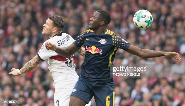 Stuttgart's forward Daniel Ginczek and Leipzig's French defender Ibrahima Konate vie for the ball during the German first division Bundesliga...