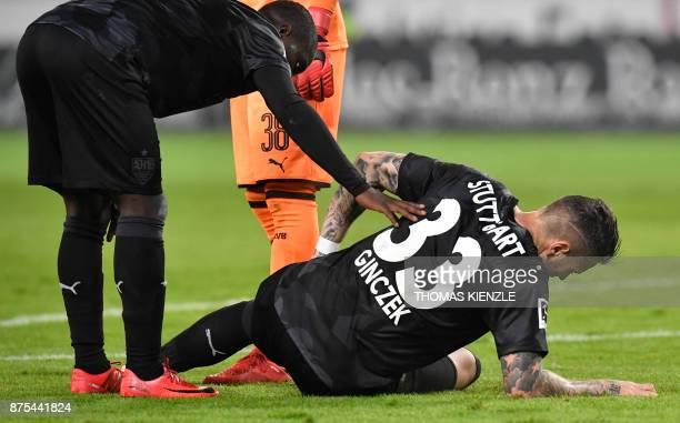 Stuttgart's forward Daniel Ginczek is injured during the German first division Bundesliga football match VfB Stuttgart vs BVB Borussia Dortmund in...