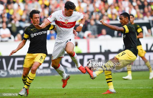 Stuttgart's forward Mario Gomez and Dortmund's Danish midfielder Thomas Delaney and French defender Abdou Diallo vie for the ball during the German...