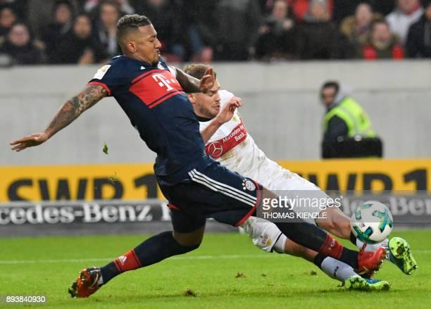 Stuttgart's forward Simon Terodde and Bayern's Munich's defender Jerome Boateng vie for the ball during the German first division Bundesliga football...