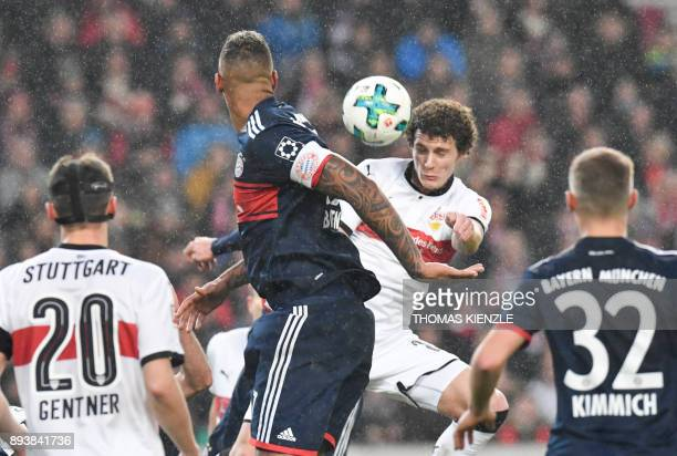 Stuttgart's French defender Benjamin Pavard and Bayern Munich's defender Jerome Boateng vie for the ball during the German first division Bundesliga...