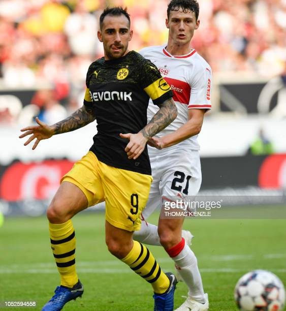 Stuttgart's French defender Benjamin Pavard and Dortmund's Spanish forward Paco Alcacer vie for the ball during the German first division Bundesliga...