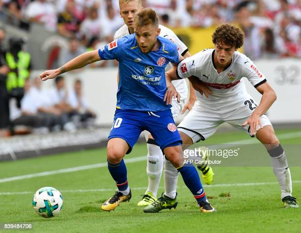 Stuttgart's French defender Benjamin Pavard and Mainz' Romanian midfielder Alexandru Maxim vie for the ball during the German First division...