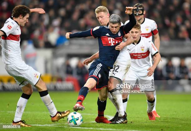 Stuttgart's French defender Benjamin Pavard Argentinean midfielder Santiago Ascacibar and Munich's Polish forward Robert Lewandowski vie for the ball...