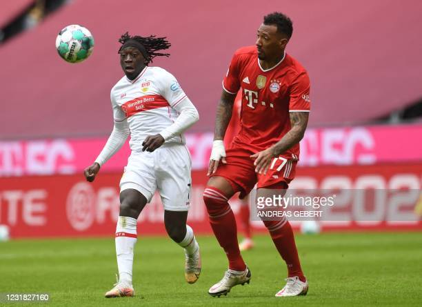 Stuttgart's French forward Tanguy Coulibaly and Bayern Munich's German defender Jerome Boateng vie for the ball during the German first division...
