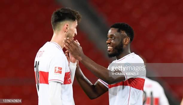 Stuttgart's German defender Atakan Karazor and Stuttgart's Belgian midfielder Orel Mangala react after the German first division Bundesliga football...