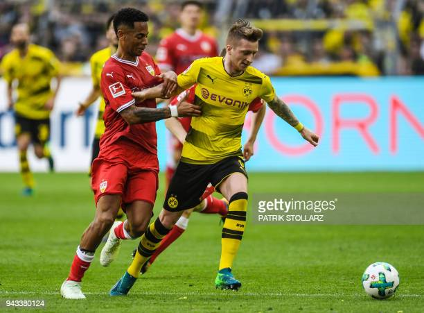 Stuttgart's German defender Dennis Aogo and Dortmund's German forward Marco Reus vie for the ball during the German first division Bundesliga...