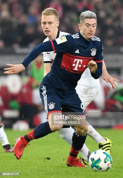 Stuttgart's German defender Timo Baumgartl and Munich's Polish forward Robert Lewandowski vie for the ball during the German first division...
