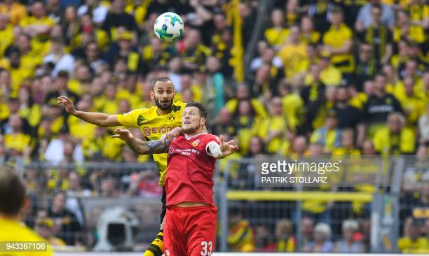 Stuttgart's German forward Daniel Ginczek and Dortmund's Turkish defender Omer Toprak vie for the ball during the German first division Bundesliga...