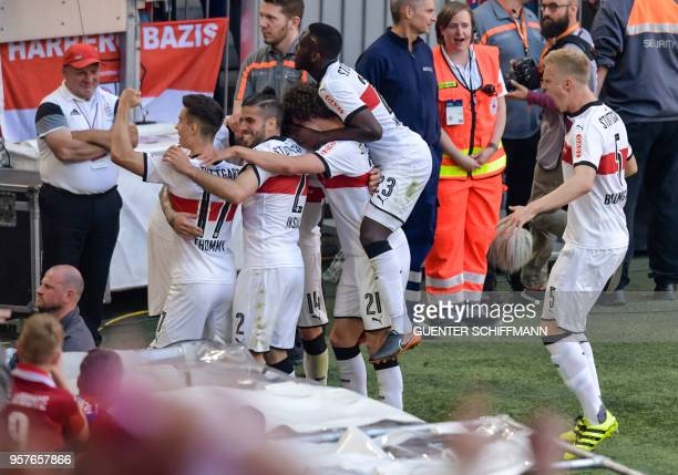 Stuttgart's German forward Daniel Ginczek celebrates the forth goal with teammates during the German first division Bundesliga football match FC...
