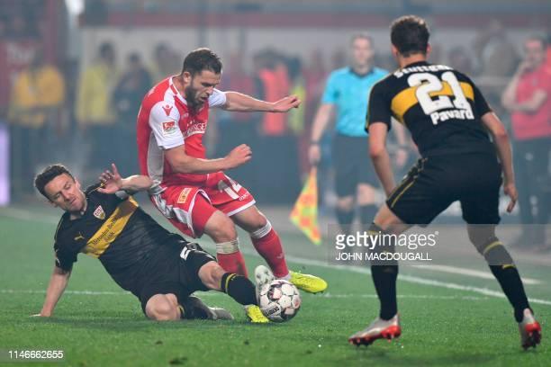 Stuttgart's German midfielder Christian Gentner and Union Berlin's German defender Ken Reichel vie for the ball during the German Bundesliga...