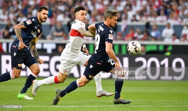 Stuttgart's Greek forward Anastasios Donis and Berlin's German defender Michael Parensen vie for the ball during the German Bundesliga Relegation...
