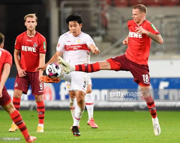 Stuttgart's Japanese midfielder Wataru Endo vies with Cologne's Slovakian midfielder Ondrej Duda and Swedish forward Sebastian Andersson during the...