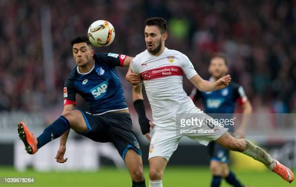 Stuttgart's Lukas Rupp in action against Hoffenheim's Nadiem Amiri during the German Bundesliga soccer match between VfB Stuttgart and TSG...