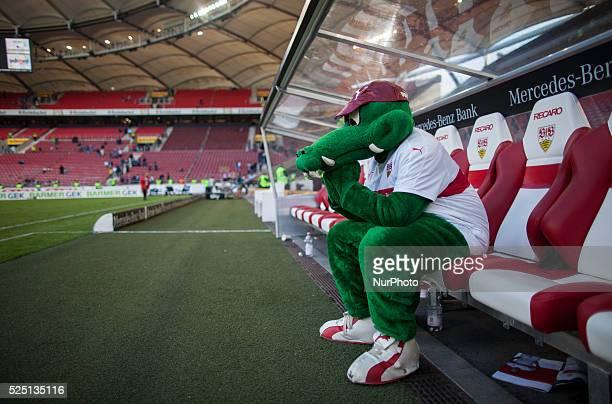 "Stuttgart's mascot crocodile ""Fritzle sits depressed on the team bench after the defeat Bundesliga match VfB Stuttgart versus Schake 04 September 20..."