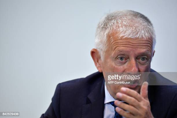 Stuttgart's mayor Fritz Kuhn attends a press conference after a meeting with the heads of German municipalities to discuss improving electric car...