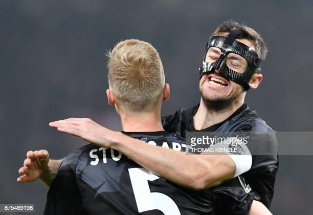 Stuttgart's midfielder Christian Gentner and defender Timo Baumgartl celebrate after winning the German first division Bundesliga football match VfB...