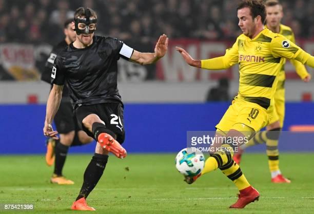Stuttgart's midfielder Christian Gentner and Dortmund's midfielder Mario Goetze vie for the ball during the German first division Bundesliga football...