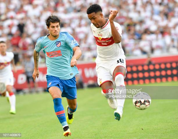 Stuttgart's midfielder Daniel Didavi and Atletico's midfielder Roberto Olabe vie for the ball during the preseason friendly football match between...