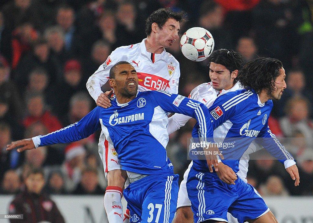 DFL. Stuttgart's midfielder Roberto Hilbert (2ndL) vies with Schalke's Dutch midfielder Orlando Engelaar (L) and striker Kevin Kuranyi (R) during their German first division Bundesliga football match VfB Stuttgart vs Schalke 04 on November 30, 2008 in Stuttgart.