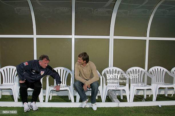Stuttgarts new team Manager Horst Heldt and Andreas Brehme assistant coach sit during the test match between VfB Stuttgart and Hansa Rostock at the...