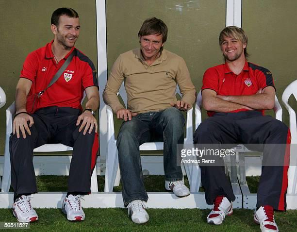 Stuttgarts new team Manager Horst Heldt takes a seat between Danijel Ljuboja and goalkeeper Timo Hildebrand during the test match between VfB...