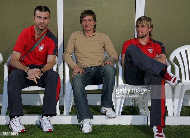 Stuttgarts new team Manager Horst Heldt takes a seat between Danijel Ljuboja and goalkeeper Timo Hildebrand during the test match between VfB...