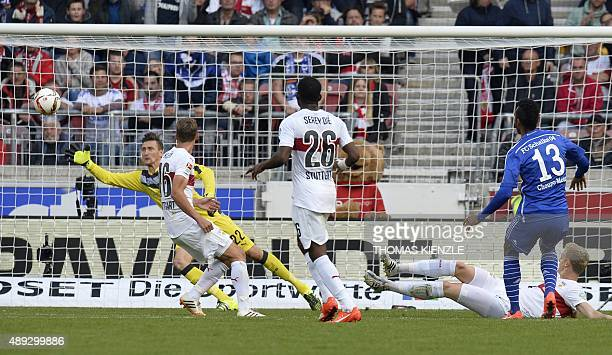 Stuttgart's Polish goalkeeper Przemyslaw Tyton saves a shot by Schalke's Cameroonian forward Eric Maxim ChoupoMoting during the German first division...