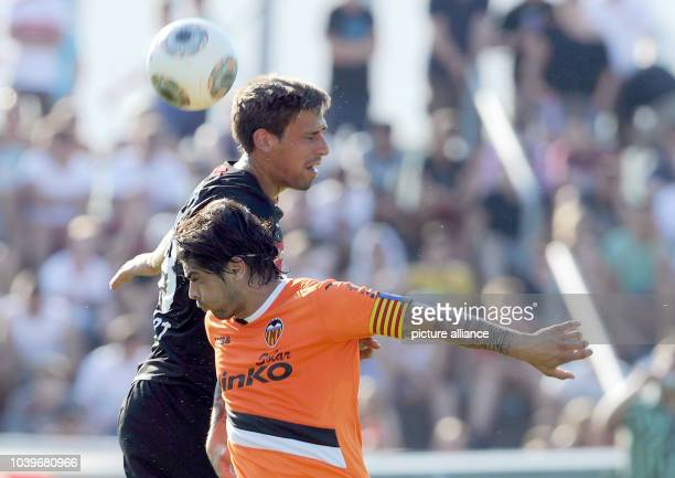 Stuttgart's Rani Khedira vies for the ball with Valencia's Ever Banega during the test match between VfB Stuttgart and FC Valencia at...