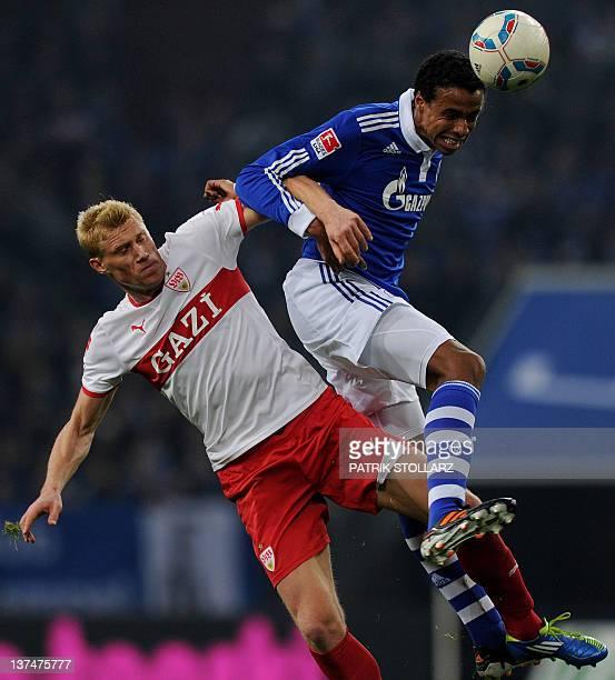 Stuttgart's Russian striker Pavel Pogrebnyak and Schalke's midfielder from Cameroon Joel Matip vie for the ball during the German first division...