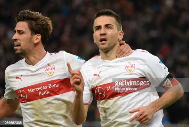 Stuttgart's Vedad Ibisevic celebrates his 2-2 goal with teammate Rani Khedira during the Bundesliga soccer match between VfB Stuttgart and Hannover...