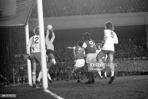 Stuy the Ajax Amsterdam goalkeeper leaps to save from Arsenal No 5 Frank McLintock
