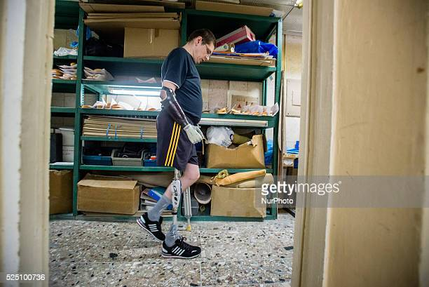 Stuzhenko Vasyl who lost his arm and a leg during fighting near Illovaisk in the Donetsk region last August learns to walk with his new bionic leg...